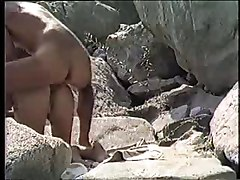 Amateur couple doggystile on the beach