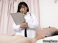 Sexy asian nurse observes patients erection