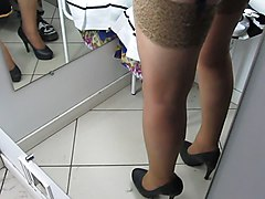 Girl in stockings with garter belt in fitting room