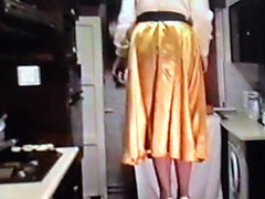 wife in gold satin skirt dominated by husband