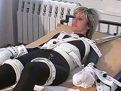 Girl In Bondage Bed, Cuffs And Shackles