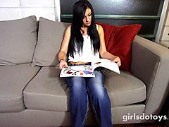 cute young brunette teen masturbates on couch with big green dildo