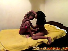 Hot Ebony lesbians masturbate together