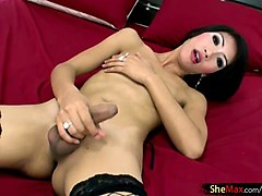 thai tranny in latex lingerie strokes rafes cock and her own