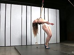lovely white chick bound tight and suspended in the air
