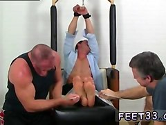 sexy gay boy gets his feet tickled and worshiped by two twinks