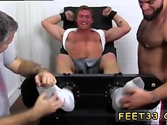 athletic guy gets tickled and feet worshiped by two fruits