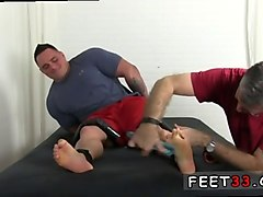 cute hunk gets his feet tickled by an ugly twink