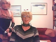 Two nice clothed crossdressers in a blowjob-clip