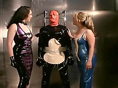 Two Mistresses Dress Slave Up in Latex