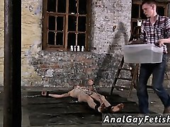 gay twink bondage speedos chained to the warehouse floor and