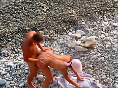 lewd amateur couple was fucking on the beach and in the sea