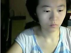 asian serious or even dull looking webcam asian whore exposed her tits