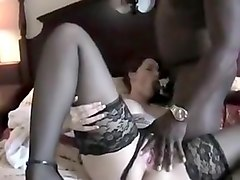 Busty brunette milf with black dudes sucking and fucking his big black beef