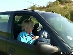 old granny rides my cock right in the car!