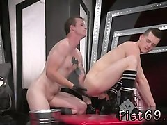 gay male holding cum with butt plug in an acrobatic 69, axel