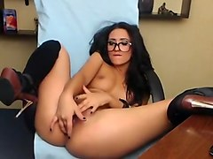 Sexy brunette nerd fingering her hit tight pussy at home on webcam