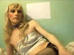Crossdresser TV Sandra poses and sucks dildos