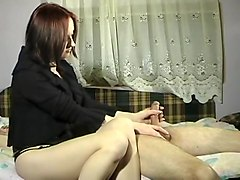 Adorable lady sends her hands slowly taking her lover's dic