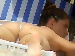 Hot girl shows her ass in a tiny thong