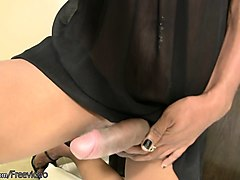 dark skin ladyboy lets her huge cock hang out of her panties