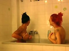 two hot and sexy babes bathing in a tub together