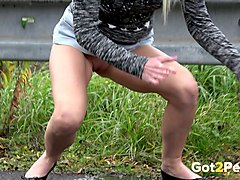 hot blonde sweetie without panties pisses on the pavement