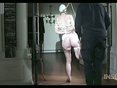 white chick in white lingerie bound and gagged with cloth