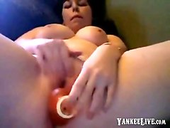 lovely gal with a plump body shoves a dildo deep in her pussy