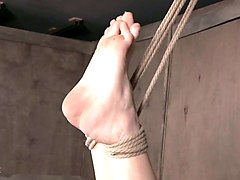 tied up with ropes blonde nympho can only moan while domme treasts her bad